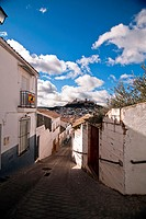 streets of the quarter of las Cruces, neighborhood very typical of this city, in the background the castle of La Mota, Alcala La real, Jaen province, ...