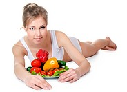 The beautiful girl with fruit and vegetables