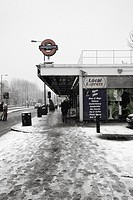 Outside Bermondsey tube station snowing, Jubilee Line, London, UK