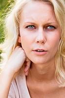 Blond woman in summer, portrait