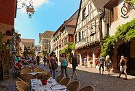 Tourists walking at the main street  Riquewihr  Alsace wine route  Haut-Rhin  Alsace  France