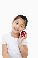 Girl smiling and holding an apple