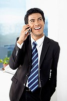 Young businessman using smart phone