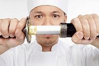 Asian chef with a samurai sword