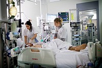 Reportage at in Robert Ballanger hospital's Intensive Care Unit in France. Two nurses in a patient's room.