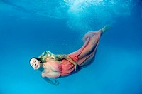 pregnant woman, underwater fashion in a pool