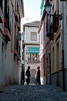 Two Moroccans speaking at the end of street in the Albaicín  Granada  Spain