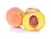 Fresh peaches isolated on white background