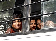 Smiling girls on a city bus  New Delhi, India