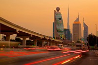 City skyline and car trail lights at sunset, Dubai, United Arab Emirates, Middle East