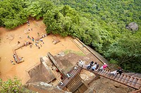 Sri Lanka - Sigiriya, tourists on stairs of Lion´s Gate to the ancient fortress, ancient Royal Fortress in Sri Lanka, UNESCO World Heritage Site