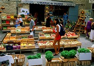 Fruit and vegetable shop and outdoor markets at village of Gourdes in Provence France