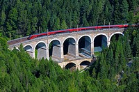 Passenger train on the Kalte Rinne Viaduct, UNESCO World Heritage Site, built 1848-1854