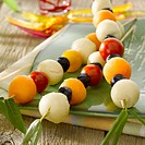 Cherry tomato,olive,melon ball and cheese aperitif brochettes