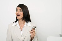 Young businesswoman listing to music on mp3 player