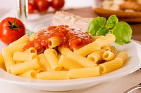 Fresh pasta with tomato sauce and basil