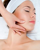 Facial massage to the woman closeup