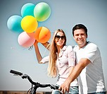 Happy smiling couple with balloons