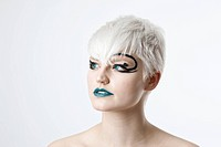 Portrait of a young woman wearing creative makeup