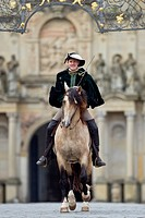 Frederiksborger with rider in historic costume galloping in the courtyard of Frederiksborg Palace, Danmark