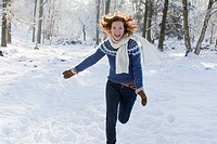 Caucasian woman playing in snow
