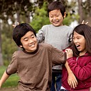 Asian children playing together outdoors