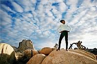 Black runner in desert landscape, Joshua Tree National Park, California, United States