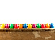 Colorful easter eggs on old wooden background.