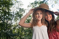 Teenage girls wearing straw hat outdoors