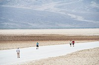 people walk in the desert at Badwater, Death Valley National Park, California, USA