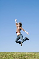 Woman jumping for joy, Jena, Thuringia, Germany