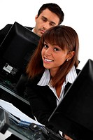 female executive and male colleague working on laptop