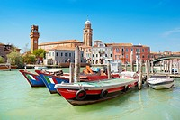 Murano - boats moored on the main canal, Murano Island, Italy.