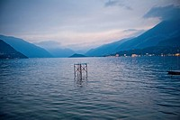 Diving Board and Platform in Middle of Lake at Sunset, Italy
