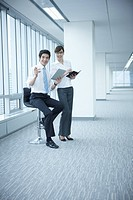 businessman and businesswoman working in an empty office