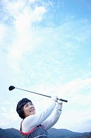 a woman doing golf swing