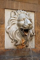 Lion statue spitting water
