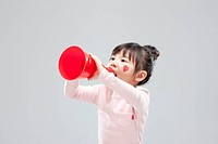 a girl shouting on red megaphone