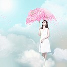 a woman holding a flower umbrella in the sky