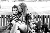 Mom With Daughter and Son on Park Bench