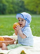 Spending time with child outside. Baby boy on a picnic.