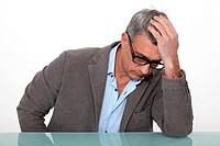 Desperate man sitting at a desk