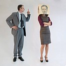Businessman scolding businesswoman wearing mask