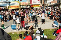 a crowd watches performers at Venice Beach, Los Angeles, California, USA