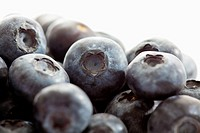 Blueberries against white background, close up