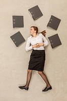 Businesswoman standing around files