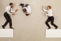 Business people jumping over platform gap