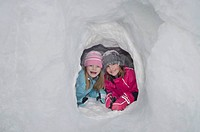 Austria, Girls in igloo, smiling