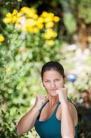 Austria, Salzburg, Young woman posing in garden, portrait