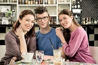 Germany, Bavaria, Munich, Portrait of young friends in cafe, smiling